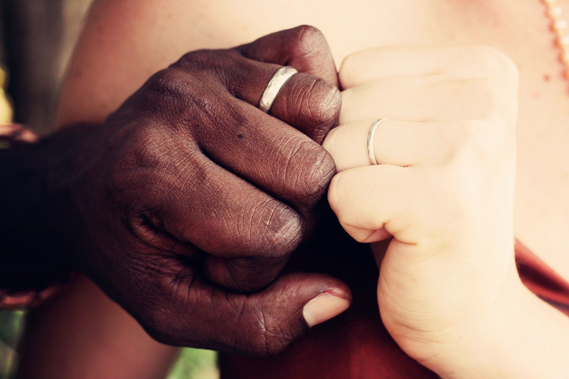 Interracial Couple Touching Hands